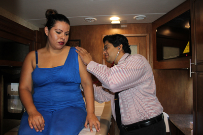 Woman receiving care inside the Regional Center for Border Health mobile clinic